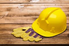 Hardhat. Helmet work tool hat protective glove protective workwear toughness stock photo
