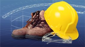 Hardhat. Industrial clothes goggles concrete room safety goggles protective leather boots stock photo