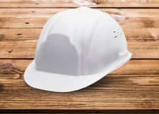 Hardhat. White hat helmet toughness construction solid royalty free stock photography