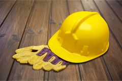 Hardhat. Helmet work tool hat protective glove protective workwear toughness stock photos