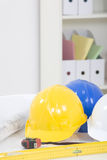 Hardhat  and measuring instruments Royalty Free Stock Photos
