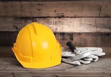 Hardhat and old leather gloves Stock Photography