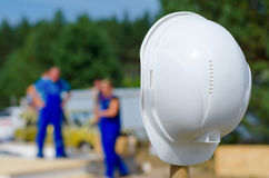 Hardhat on a pole at a building site Royalty Free Stock Photos