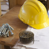Hardhat, site plan and nails Stock Image