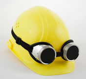 Hardhat and welding goggles Stock Photo