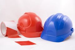Hardhats and Caution Tape Royalty Free Stock Photography