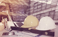 Hardhats on large plant background Royalty Free Stock Images