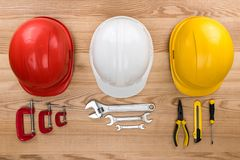 Hardhats and reparement tools royalty free stock photos