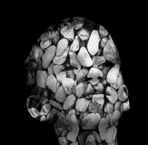 Hardheaded. Boy's head covered in stones, b&w image Stock Photos