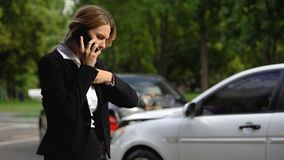 Hardly breathing woman calling husband after car crash, lack of experience. Stock footage stock video footage