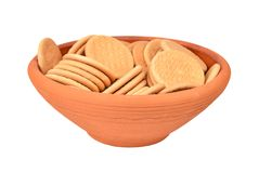 Hardtack cookie in clay bowl. Some hardtack cookie in clay bowl, isolated on white background Stock Photo