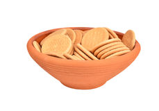 Hardtack cookie in clay bowl. Some hardtack cookie in clay bowl, isolated on white background Stock Photography