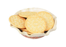 Hardtack cookie in clay bowl. Some hardtack cookie in clay bowl, isolated on white background Royalty Free Stock Photography