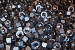 Hardware bolts nuts closeup background Stock Photo
