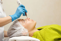 Hardware cosmetology. Mesotherapy. Dermapen. Treatment of the nasal zone. Spa treatments. Face rejuvenation Stock Images