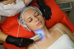 Hardware cosmetology. Ultrasonic face cleaning royalty free stock image