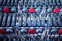 IT hardware. Cryptocurrency business equipment. Two rows of electrical devices stock image