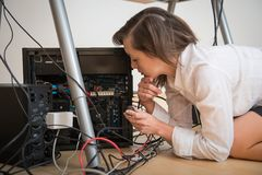 Hardware problems - woman repairing computer Royalty Free Stock Photo