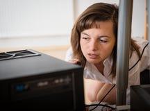 Hardware problems - woman repairing computer stock photos