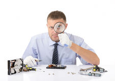 Hardware repairman with a magnifying glass Royalty Free Stock Photos