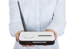 Hardware senza fili del router del modem in palma della donna Fotografia Stock Libera da Diritti