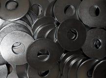Hardware shop. Iron washers in box closeup Royalty Free Stock Photography