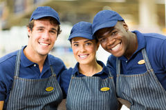 Hardware shop workers. Group of happy hardware shop workers Royalty Free Stock Photo