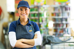 Hardware store employee. Pretty hardware store employee looking at the camera Stock Photography
