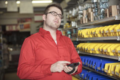 Hardware store employee. A employee of a hardware store at work Stock Photography