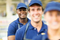 Hardware store worker colleagues. Portrait of happy afro american hardware store worker with colleagues Stock Photography