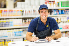Hardware store worker. Young male hardware store worker Stock Image