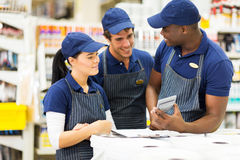 Hardware store workers. Group of hardware store workers discussing work Stock Images