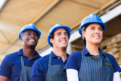 Hardware store workers. Outside building material warehouse Stock Images