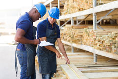 Hardware store workers. Working in timber warehouse Stock Image