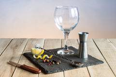 Hardware to prepare Gin Tonic with botanicals and bar spoon on wood table. Royalty Free Stock Photography