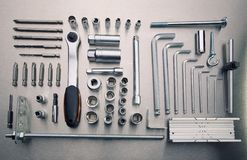 Hardware Tools. Set of Different Hardware Tools on metal desk Stock Image