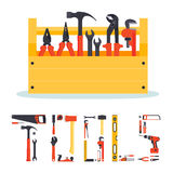 Hardware tools box with letters. Flat wooden hardware tools box with instruments in it and the letters made from tools Royalty Free Stock Photos