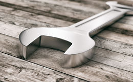 Hardware tools, wrenches. Close-up view of a wrench on wooden background (3d render royalty free illustration