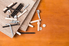 Hardware and Wood Planks for Furniture Assembly Stock Photos