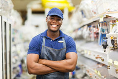 Hardware worker. Cheerful afro american hardware worker with arms crossed Royalty Free Stock Image