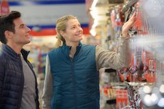Hardwarer store worker assisting customer stock image