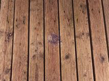 Hardwood board made of hardwood resists weathering. Wooden pier above sea. Touristic mole with still  wet wooden floor above sea. Soft focus Royalty Free Stock Photo