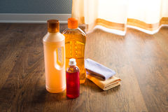 Hardwood floor cleaners. Detergent products for hardwood floor care and manteinance on parquet Stock Image
