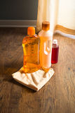 Hardwood floor cleaners. Detergent products for hardwood floor care and manteinance on parquet Royalty Free Stock Image