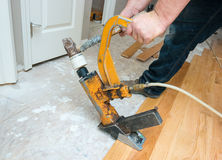 Hardwood Floor Installation. A hardwood floor installation in progress Royalty Free Stock Photography
