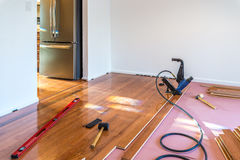 Hardwood floor installation. Hardwood floor and installation tools stock photography