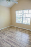 Hardwood Floor in New Bedroom. New hardwood floor in an empty house with ceiling fan overhead Stock Photography