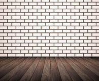 Hardwood floor with white brick wall Royalty Free Stock Image