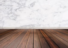 Hardwood floor with white marble stone wall texture background Royalty Free Stock Photos