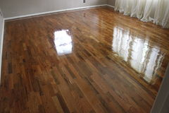 Hardwood Flooring in Home. Beautiful hardwood flooring in living room area stock photos